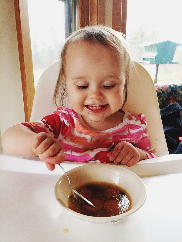 Enjoying her soup...