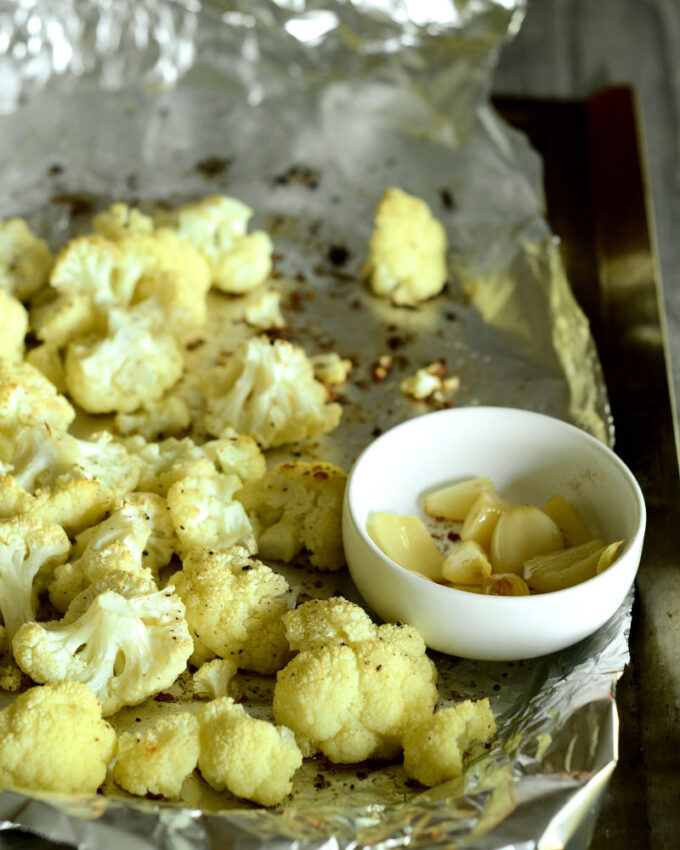 A pan of roasted garlic and cauliflower.