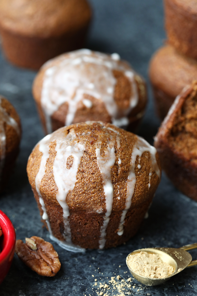 Gingerbread muffins drizzled with a glaze.