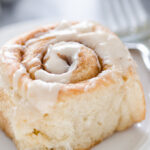 Close up shot of one of the eggnog cinnamon rolls on a plate.