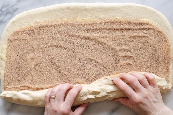 Rolling up the sourdough cinnamon rolls.