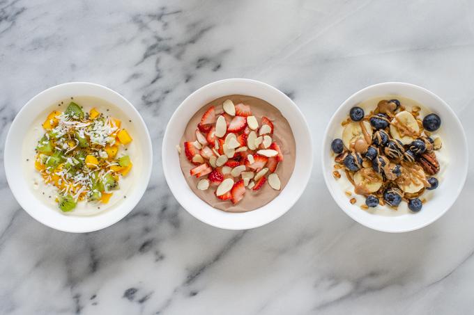 Three yogurt bowl ideas: tropical, strawberry, and granola.