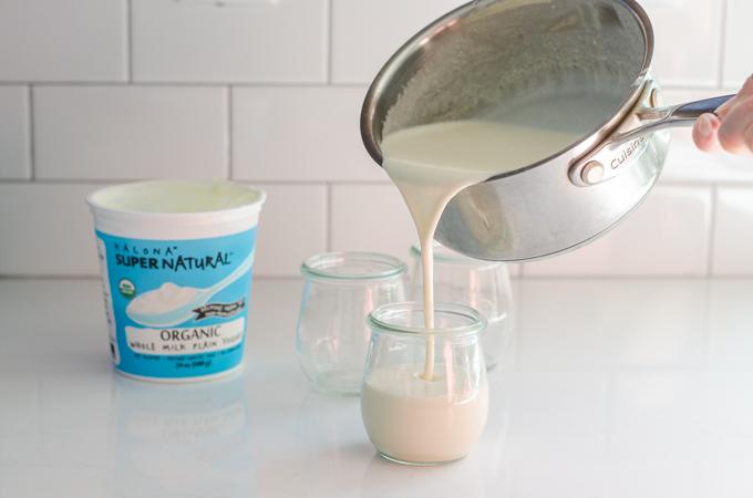 Pouring the yogurt panna cotta into individual serving jars.