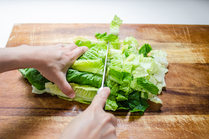 Chopping the lettuce.