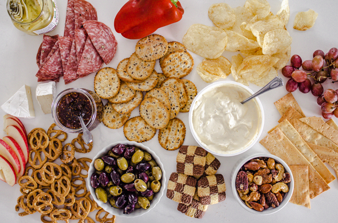 A bunch of different snacks laid out on a white counter.