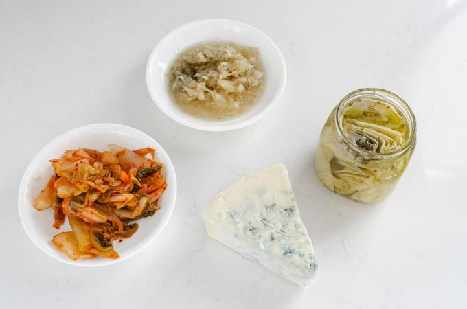 Funky snacks: kimchi, sauerkraut, artichokes, and blue cheese.