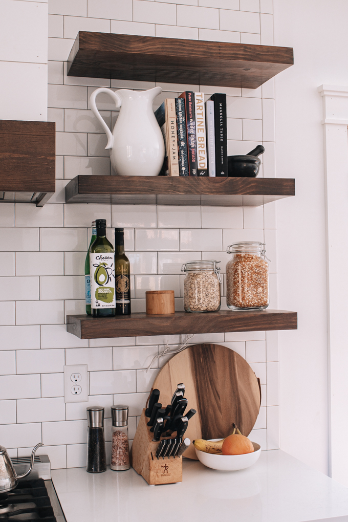 Open shelves styled with cookbooks and jars.
