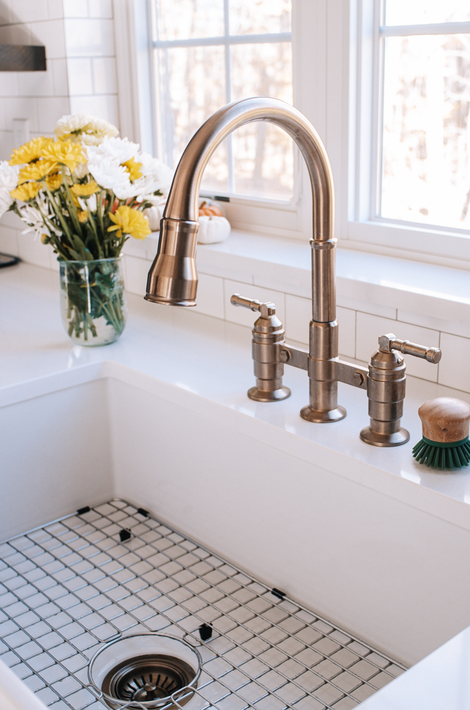 Delta Broderick two handle pull down bridge faucet in Champagne Bronze.