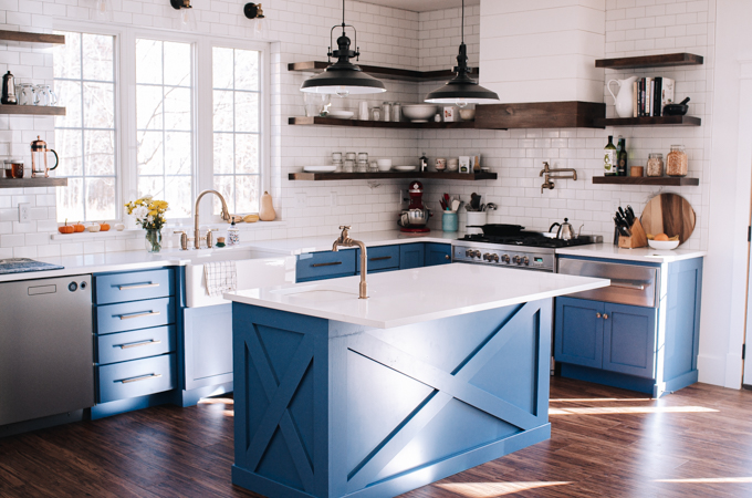 1.5 m Blue kitchen island with white countertops and decorative cross on front and sides.