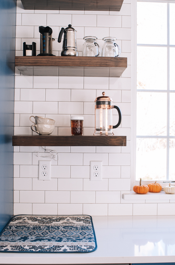 Open shelving coffee station in a transitional modern farmhouse kitchen.
