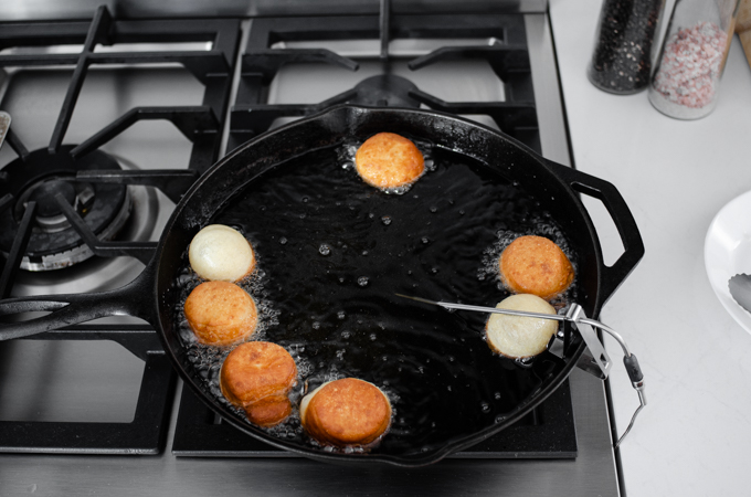 Flipping the doughnut holes.