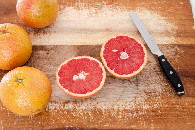 How to eat a grapefruit with a spoon: start by slicing it in half.