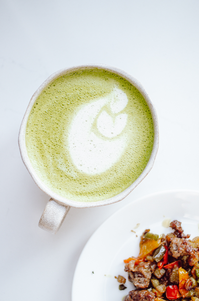 A mug of matcha oat milk latte.