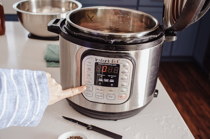 Setting the Instant Pot to the Slow Cook function.