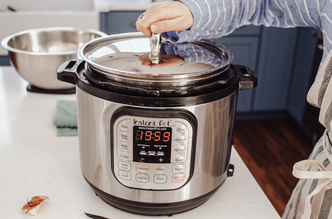 Putting a lid on the Instant Pot.