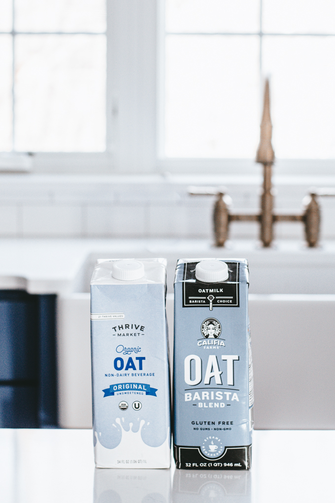Two different kinds of oat milks that you can use to make an oat milk latte.