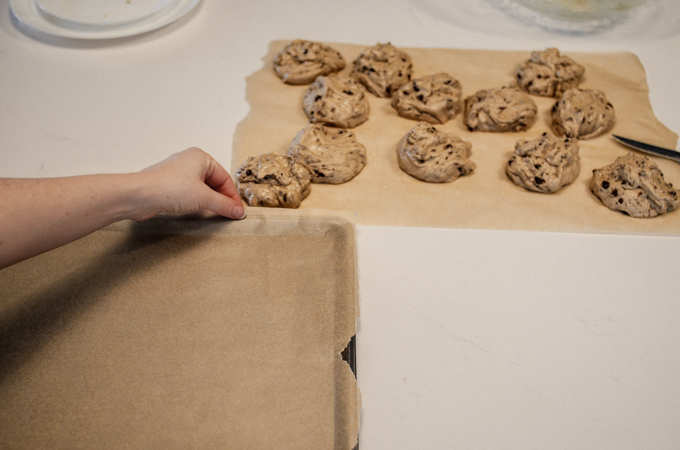Lining a rimmed baking sheet with parchment paper.