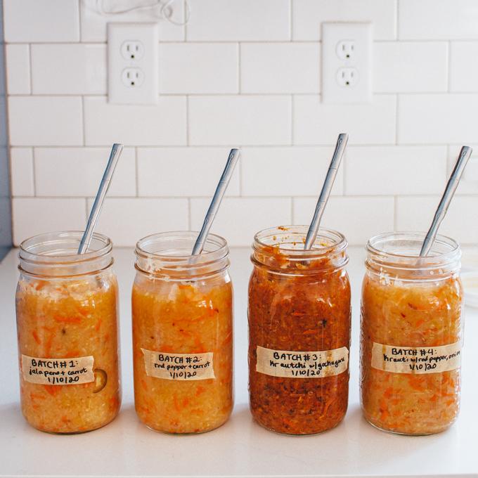 4 jars of spicy sauerkraut on a kitchencounter.