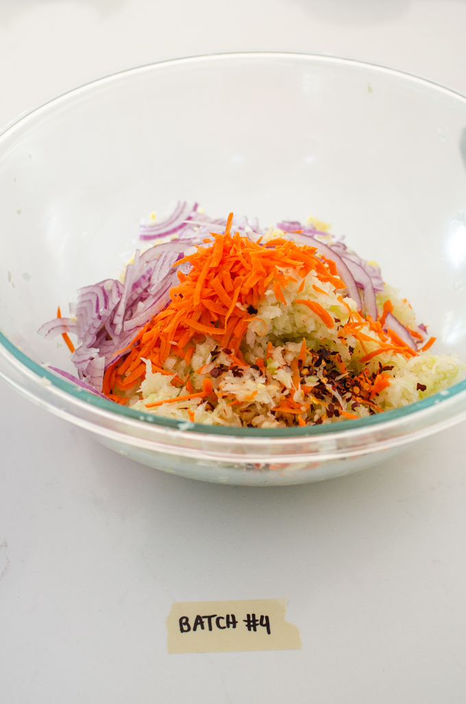 Kraut chi made with red pepper flakes, carrots, garlic, ginger, and red onion.