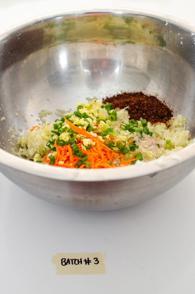 Kraut-chi made with garlic, ginger, carrots, green onions, and gochugaru (Korean red pepper flakes).