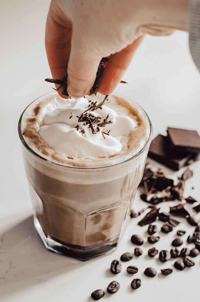 How to Make a Mocha Latte at Home: adding chopped chocolate on top of the whipped cream.