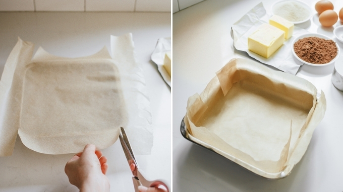 Lining a square baking pan with parchment paper.