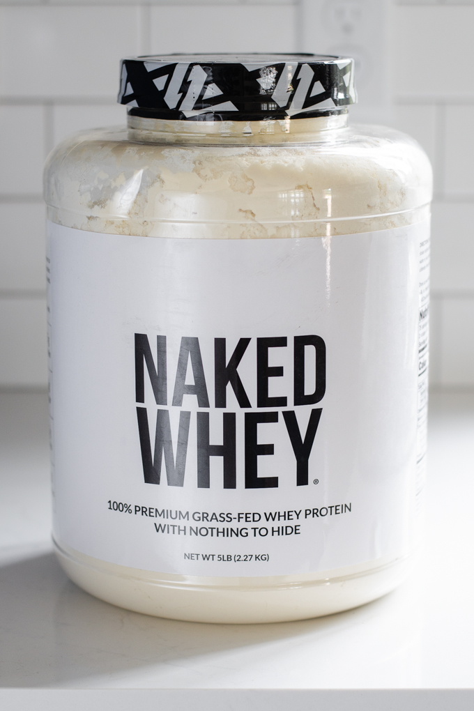 A 5 pound container of Naked Whey grass-fed protein powder from Naked Nutrition.